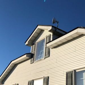 Circle dish attached to attic roof of house