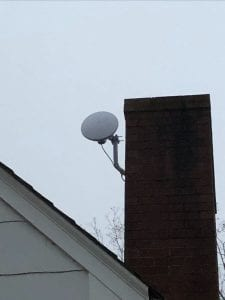 Small, circle dish attached to chimney