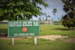Granville athletic park green sign white lettering